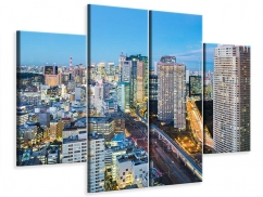 Leinwandbild 4-teilig Skyline Tokio im Lichtermeer