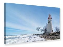 Leinwandbild Leuchtturm im Schnee