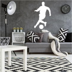Wandtattoo Fußballer laeuft mit Ball