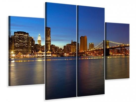 Leinwandbild 4-teilig Skyline Manhattan im Lichtermeer